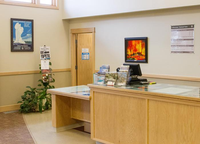 West Yellowstone Visitor Information CenterThe NPS desk is staffed in summer and winter but the building, restrooms, and West Yellowstone Chamber of Commerce desk is open year-round.