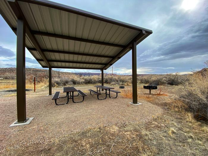 Westwater Ranger Station Group SiteShade shelter with picnic tables underneath and a grill.