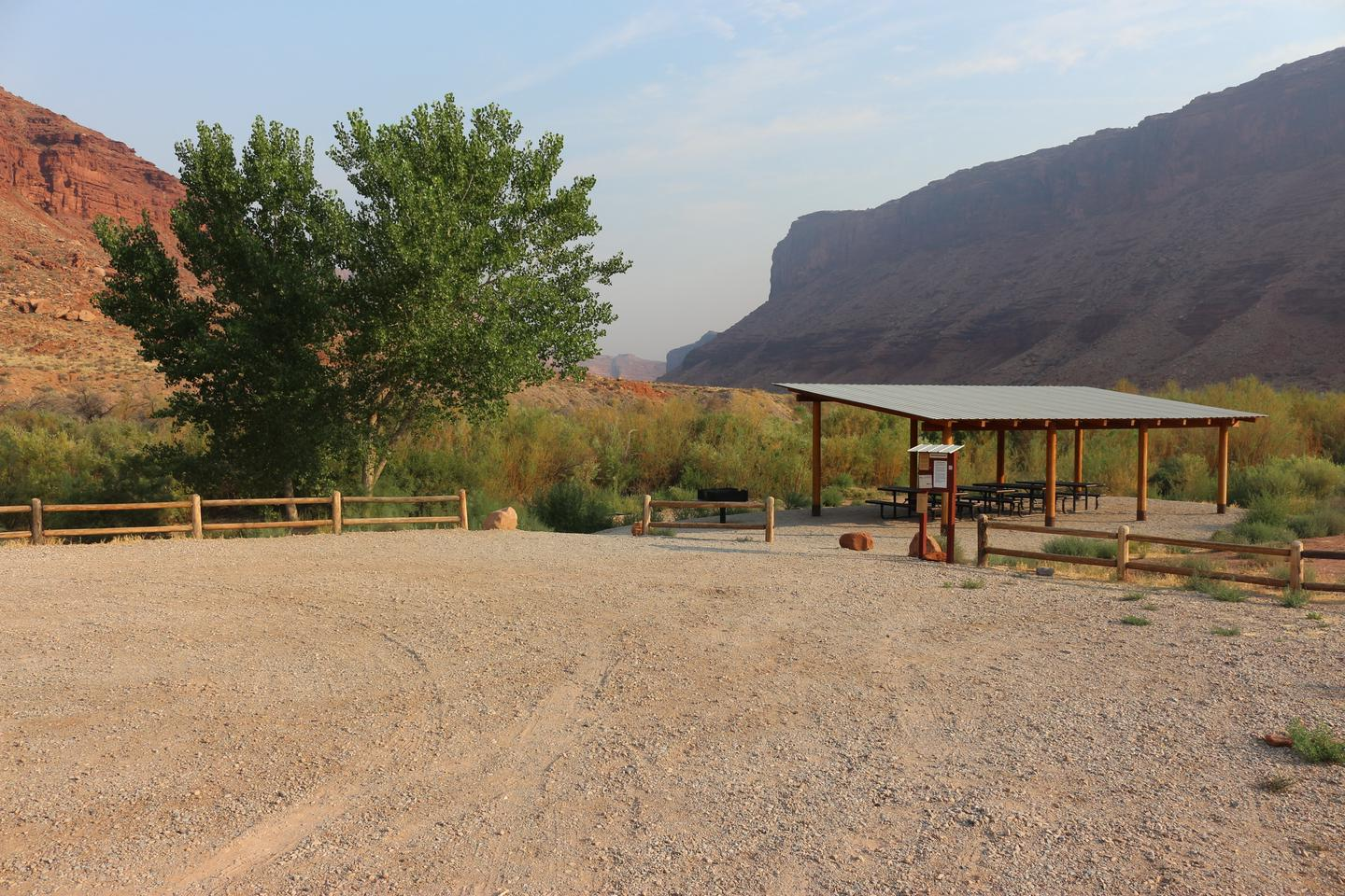 Hittle Bottom Group SitePicnic tables, shade shelter, group site sign, and parking area.