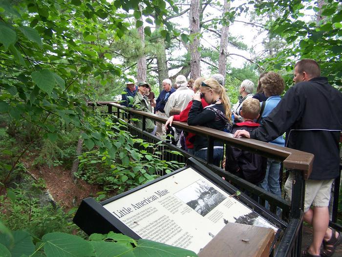 Visitors exploring along the Little American Island boardwalk
