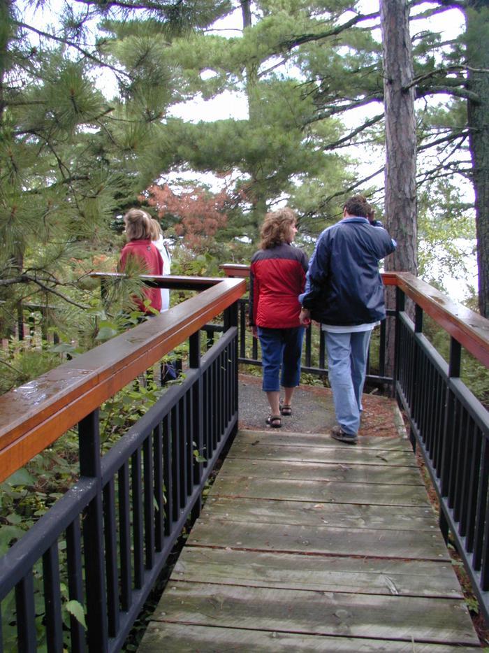 Visitors on the Little American Island boardwalk