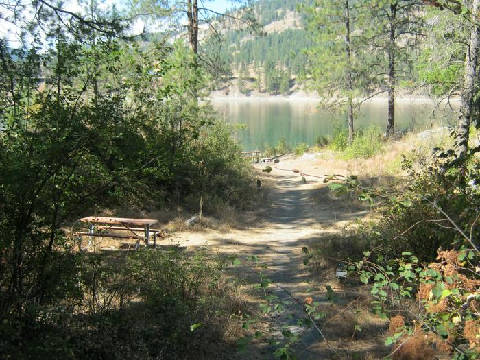 Site 9. Walk in. Trees and lake in the background.