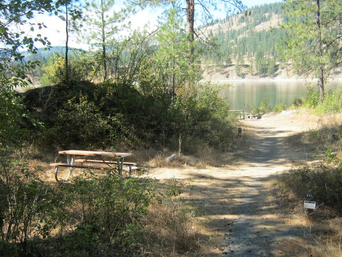 Site 10. Walk in. Trees and lake in the background.