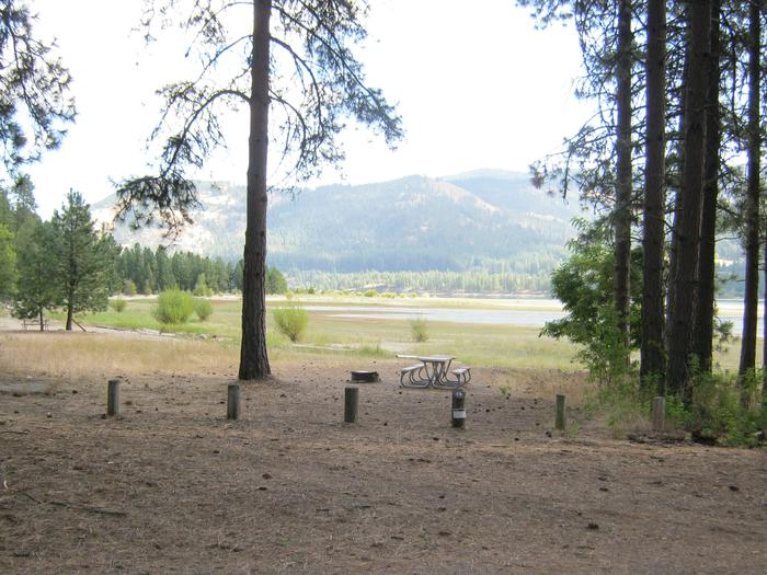 Site 13. Walk in. Trees and lake in the background.