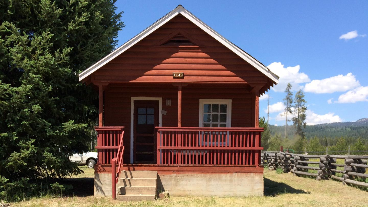 Paddy Flat Guard Station - front of rustic cabin showing porch and stairsPaddy Flat Guard Station Cabin
