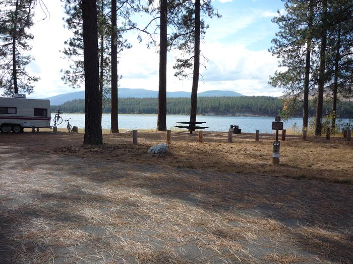 Gifford Campground with trees and lake in the background.