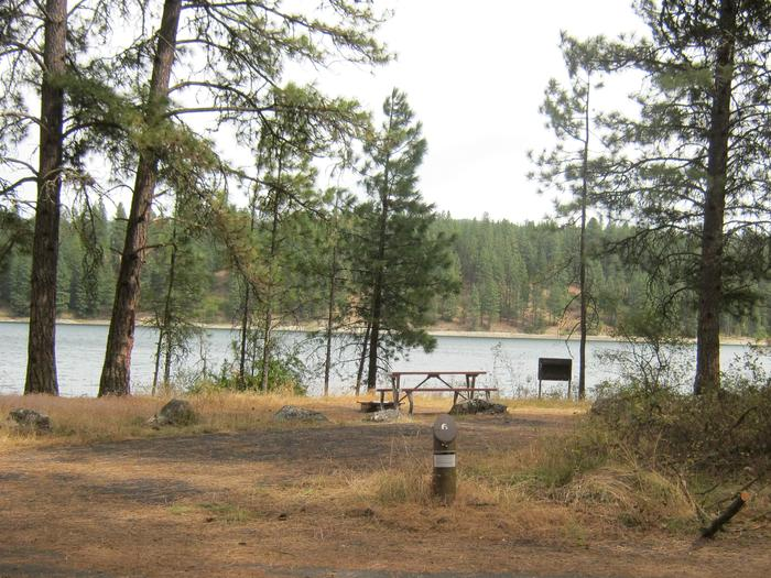 Site 6. Back in with trees and lake in the background.