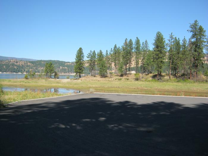 Looking towards the campground from the boat launch. Trees in the distance.