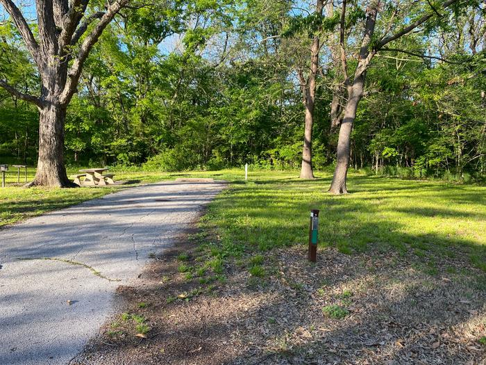 Site 7 - Afton Landing This site is heavily shaded with a paved drive/slab. The site comes equipped with a picnic table, grill and a firepit to enjoy while camping. There is also a nice open area to spread out and enjoy.