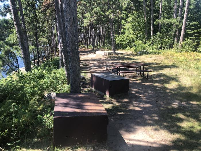 View of picnic tables and bear lockers in core area at N49 Your Island campsite