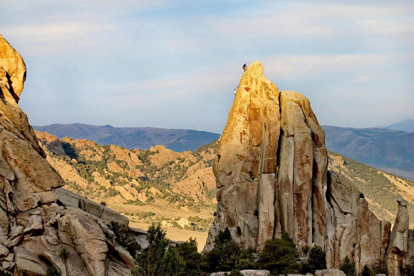 Climber on Morning Glory SpireOver half of the 100,000 annual visitors to City of Rocks come to experience climbing