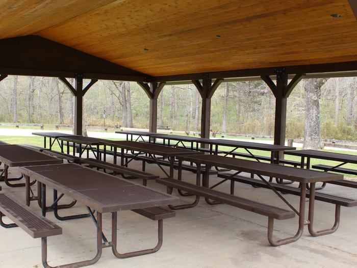 Ozark Pavilion InteriorSeveral picnic tables under the Ozark Pavilion