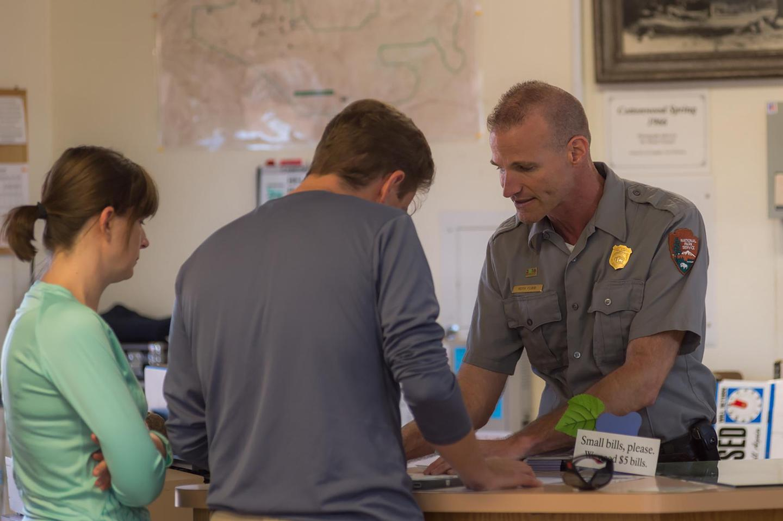 Cottonwood Visitor Center Front DeskRanger Keith Flood Helps Visitors at Cottonwood Visitor Center