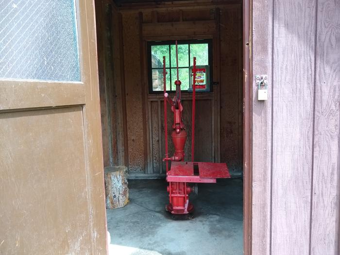 A water pump in a wooden pump house.Water at Deer Park comes from the pump house.