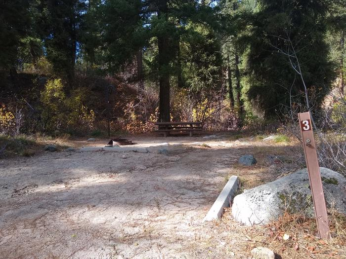 A campsite with parking beams and a picnic table, with #3 on a post.Spot 3, within Hayfork Group campground.  Please remember that individual sites cannot be reserved.  Hayfork Group Campground can only be reserved as a whole.