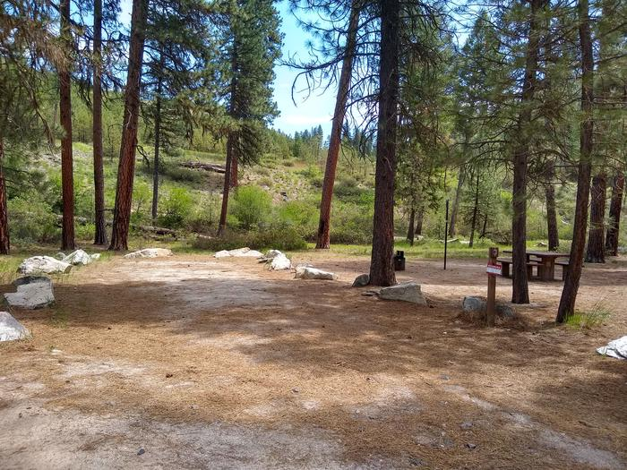 A rock-lined parking space leading to a single campsite.Site 3 at Black Rock Campground.