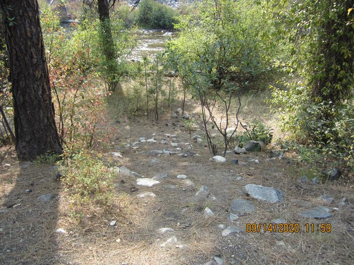 Short path to a river.This photo shows distance/terrain from the campground to the river, although some embankments may be steeper than others.
