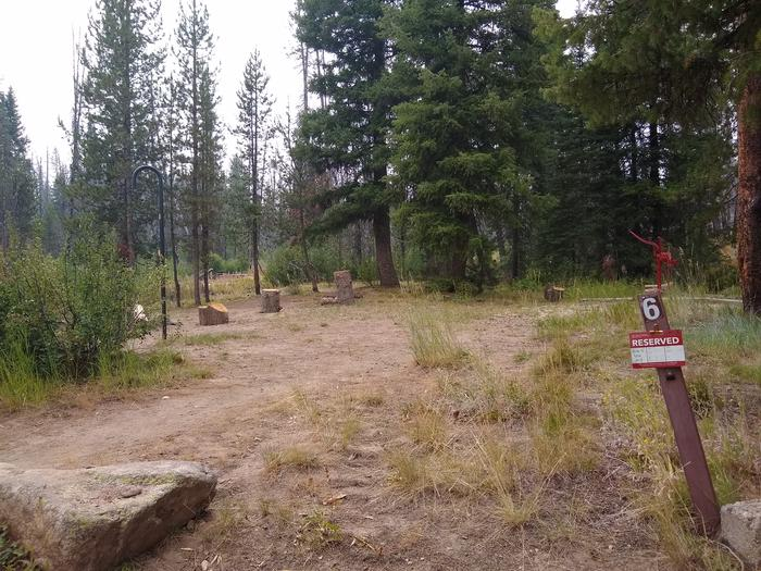 A small single campsite and driveway.Site 6 at Edna Creek Campground.