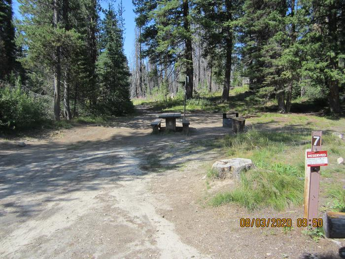 A single campsite with partial shade.Site 7 at Edna Creek Campground.
