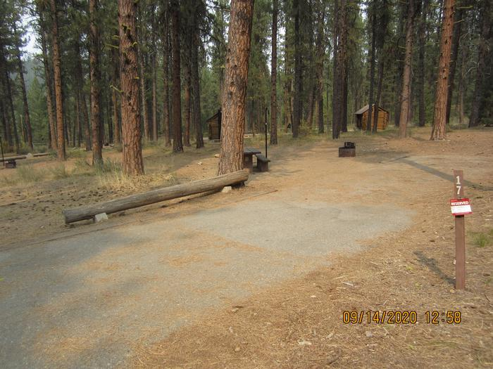 A paved long driveway to a campsite.Site 17 has a long paved driveway.