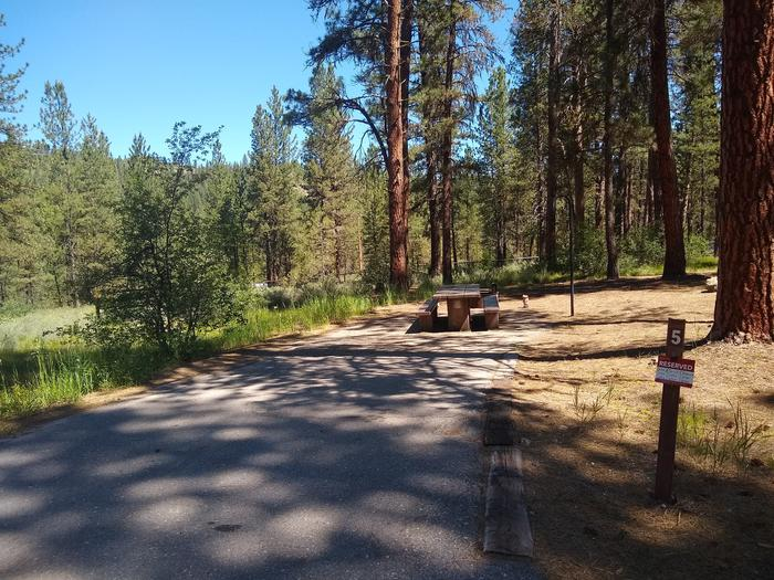 A paved driveway leading to site 5.Grayback Gulch site 5.