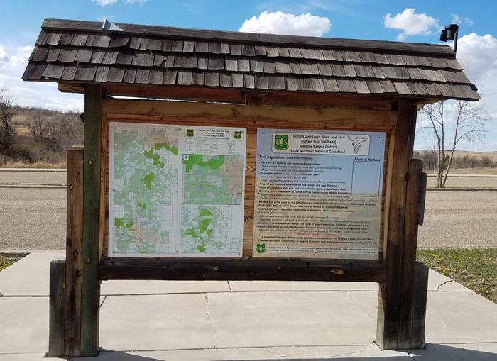An information kiosk welcomes visitors to the campground. This information kiosk outlines campground rules and highlights important information on the Buffalo Gap and Maah Daah Hey Trail.
