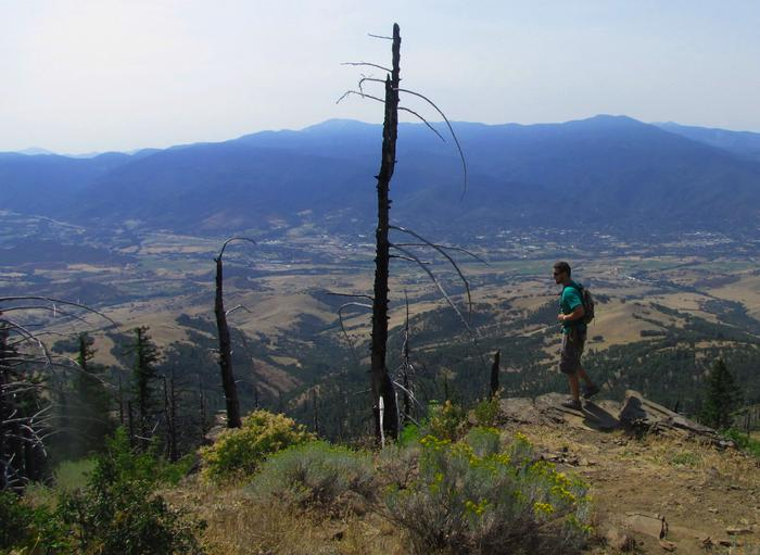 Hiker stops for a view on the Grizzly Peak Trail