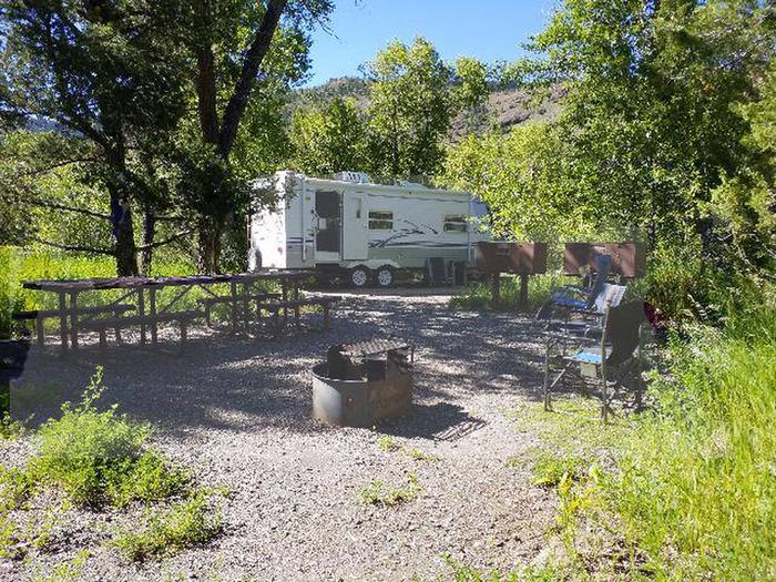 Campsite 19 with RV, picnic table. fire ring and bear boxCampsite 19