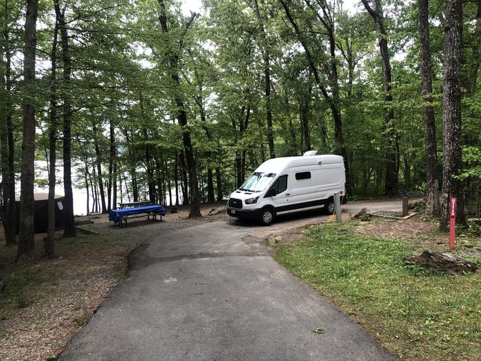 """""""Double"""" site with single electric/water connections. Large enough for 1 RV, 4 cars and 10 campers."""
