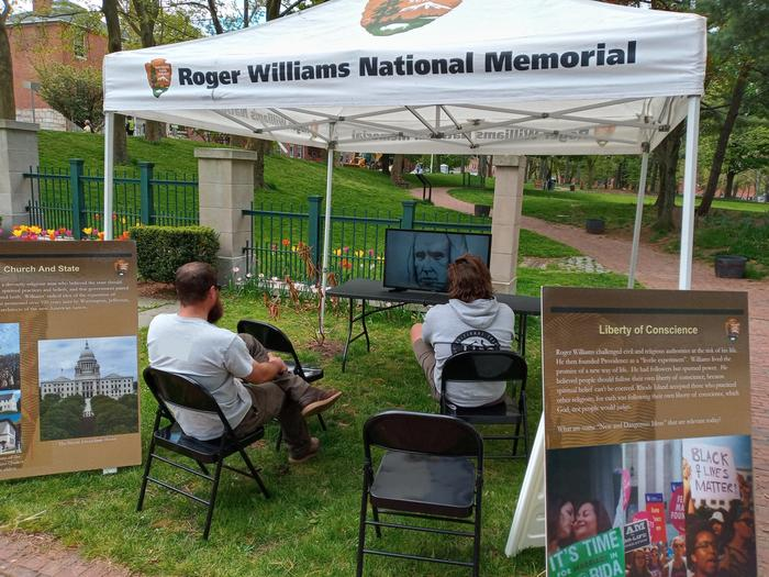 Visitors watching the Roger Williams informational video