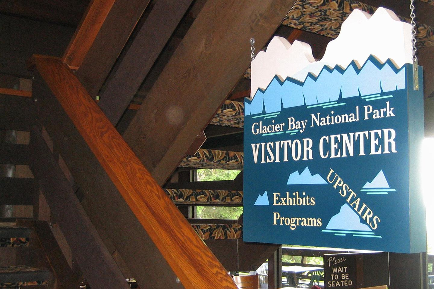 Glacier Bay Lodge Upstairs Visitor Center SignHead upstairs after you enter the Glacier Bay Lodge to find the Visitor Center.
