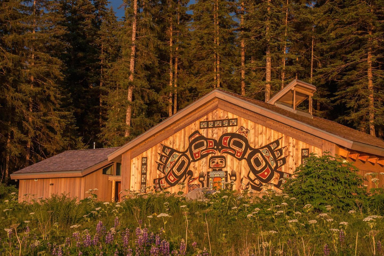 The Huna Tribal House at SunsetGolden sunlight strikes the front of the Huna Tribal House