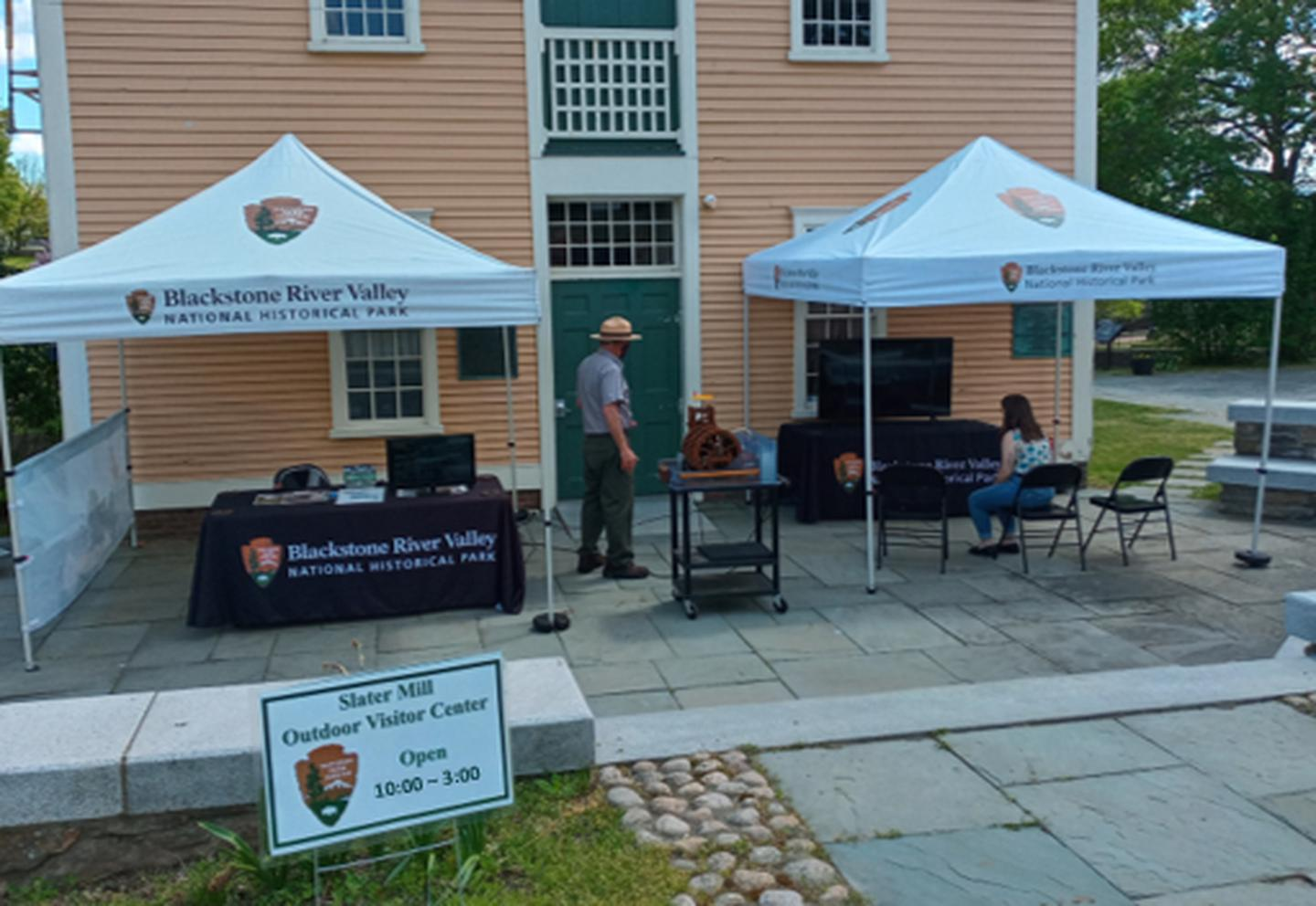 Visitor watching video at Slater Mill Outdoor Visitor Center