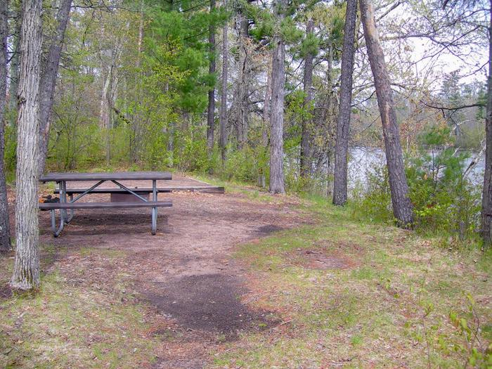 Riverside CampgroundCampsites include a picnic table, fire ring, and a pit toilet.