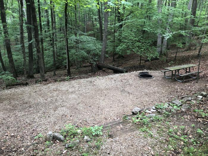 Primitive site with 2 short staircases separating parking area