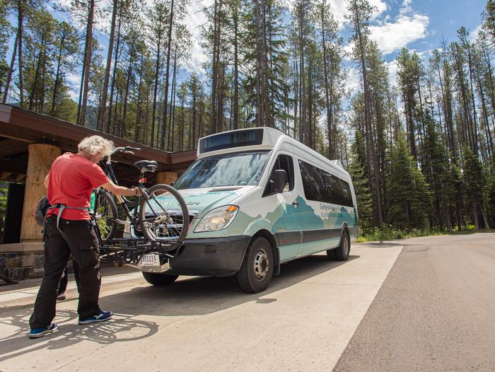 A person loading their bike onto the Glacier National Park Shuttle