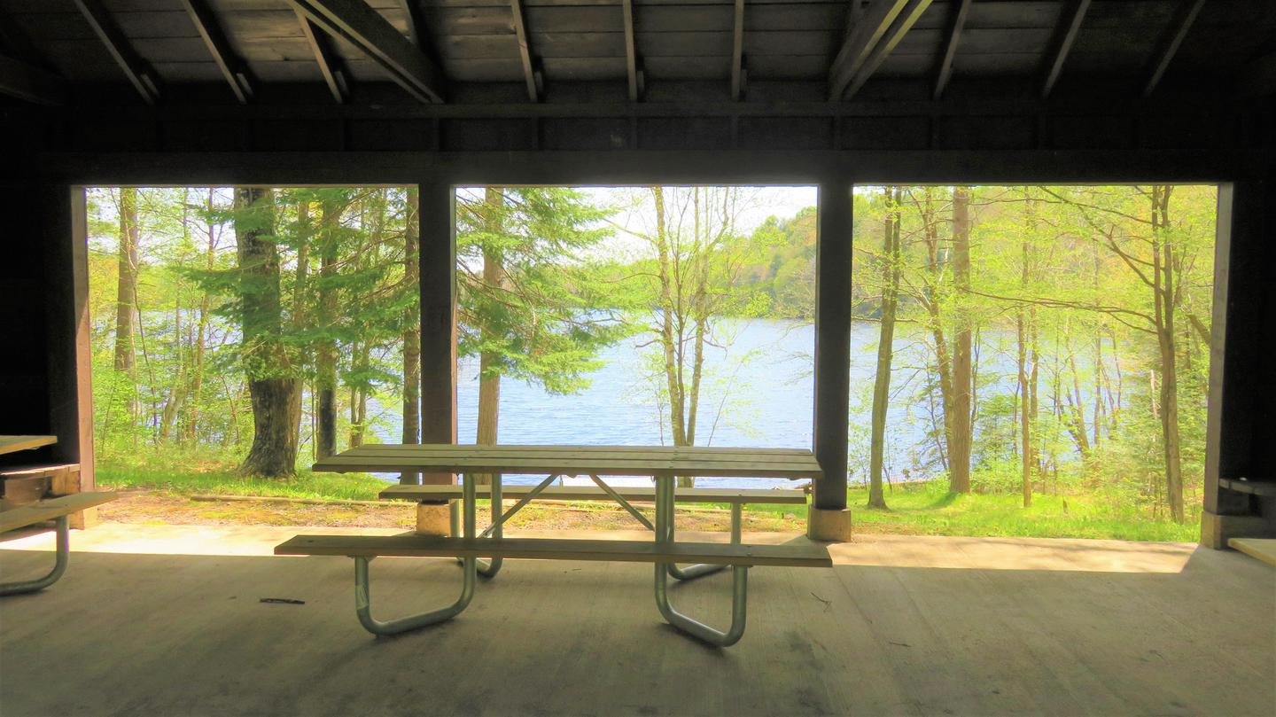 Picnic table inside shelterView of the lake from inside the Spearhead Point Shelter