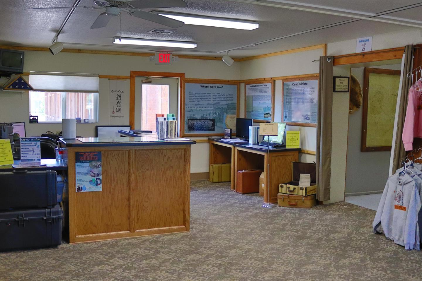 Front Desk and displaysFront Desk to the left and displays on the right