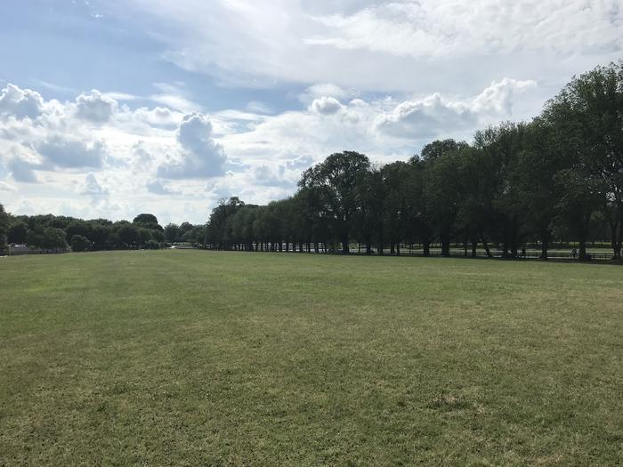 The photo shows a grassy field with trees in the backgroundLincoln Memorial Grounds Mixed Use Fields