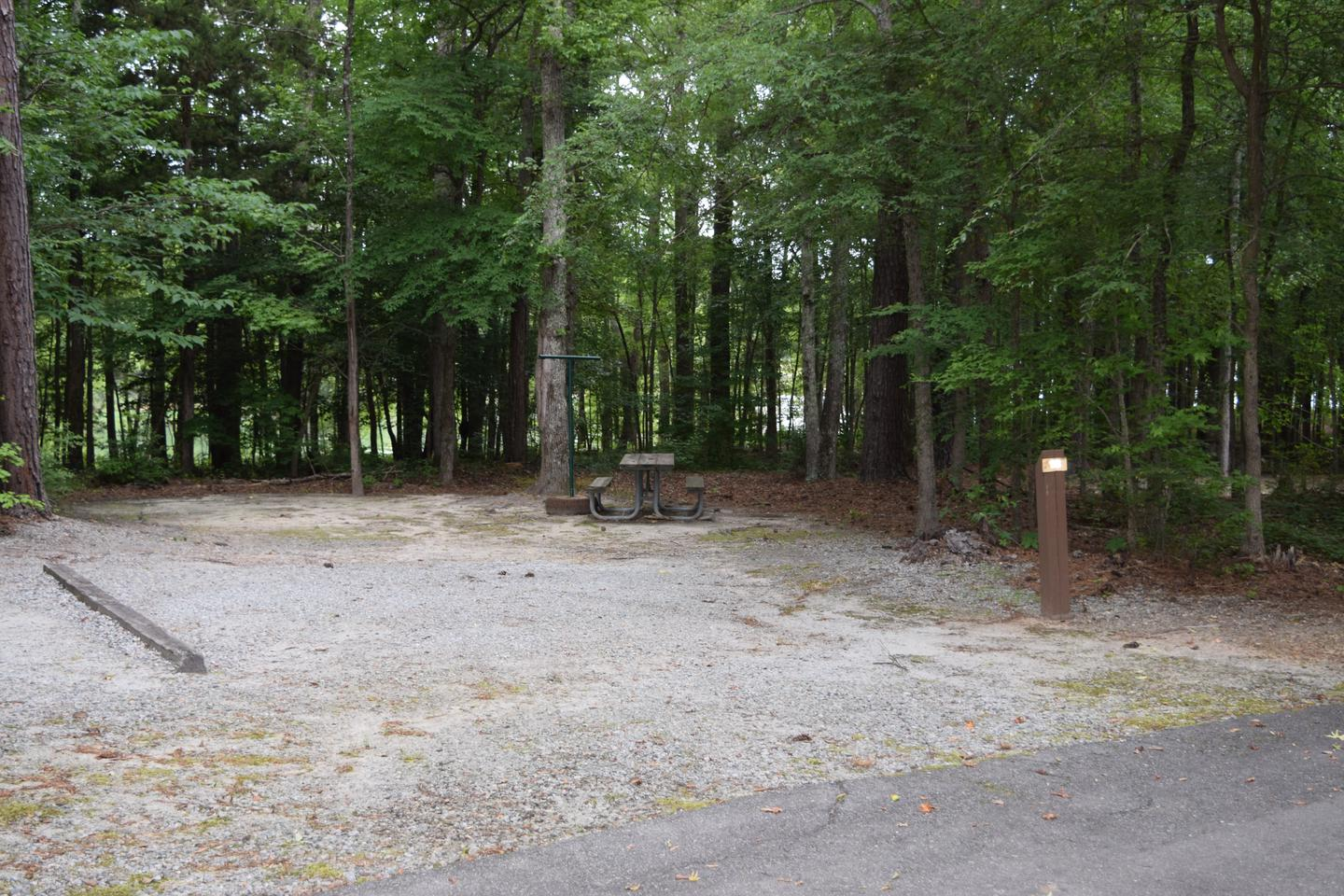 Piney Woods Campsite 17Welcome to Piney Woods Group Camping Area! This is a picture of one of the campsites within Piney Woods Group Camping Area. These campsites are designed for tent campers. Some of these campsites have campsite posts with them while others do not. Not all campsites are gravel; some of them are more dirt.