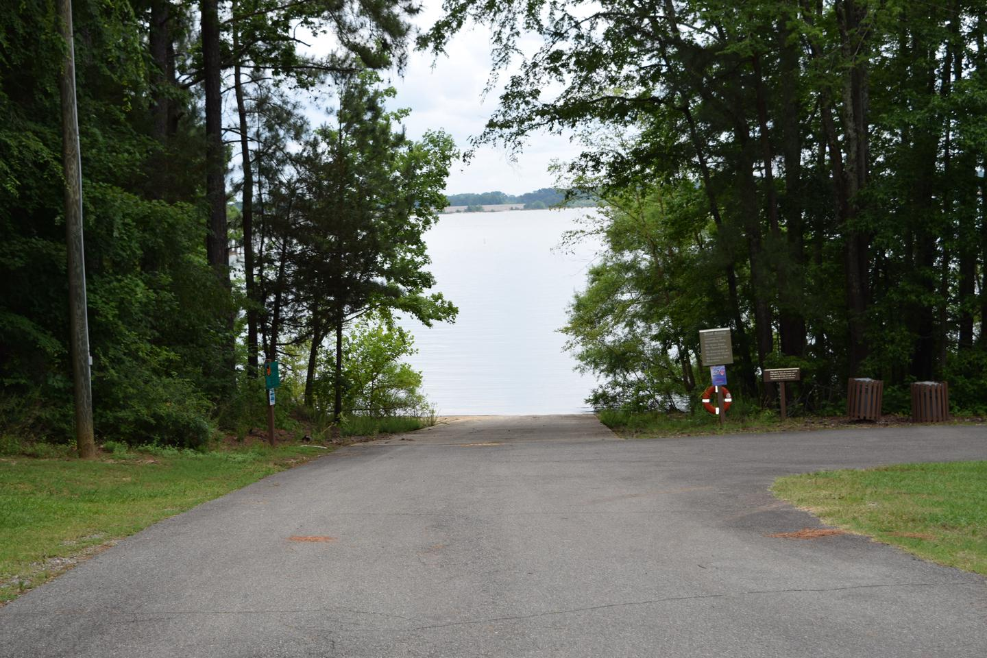 Area A Boat RampWelcome to North Bend Park! This is a picture of the Area A boat ramp. This boat ramp is open to campers as well as an over-flow area for boaters coming from the main ramp. There is no designated parking at this ramp, therefore you are allowed to park along the edges of the road. Please use caution when parking and please be sure that your vehicle and trailer are out of the way of the road and allow for other users to utilize the ramp as well.