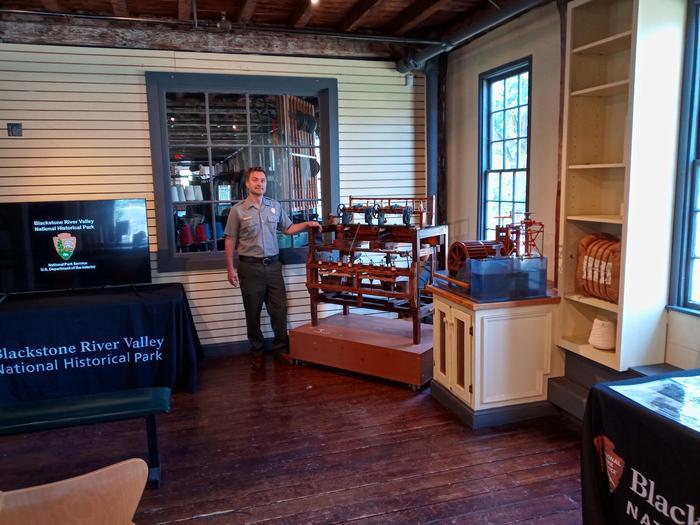 Slater Mill Visitor StationRanger explaining throstling machine in the Slater Mill Visitor Station