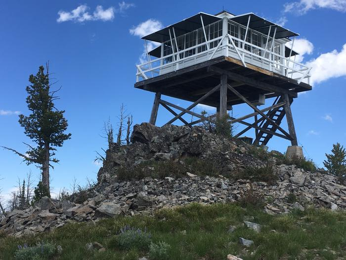 Medicine Point Lookout Outside FarAn old fire lookout sets atop a rock outcrop