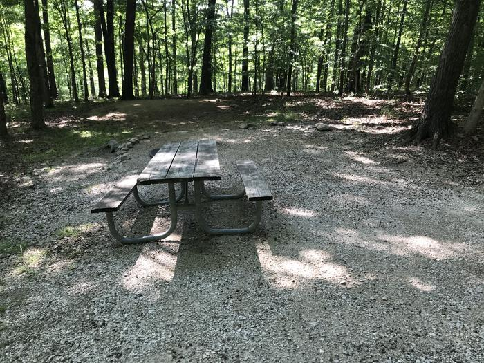 A slight drop down to the picnic and fire ring and then another slight drop down to the tent pad area nice sight very large nice surrounding trees