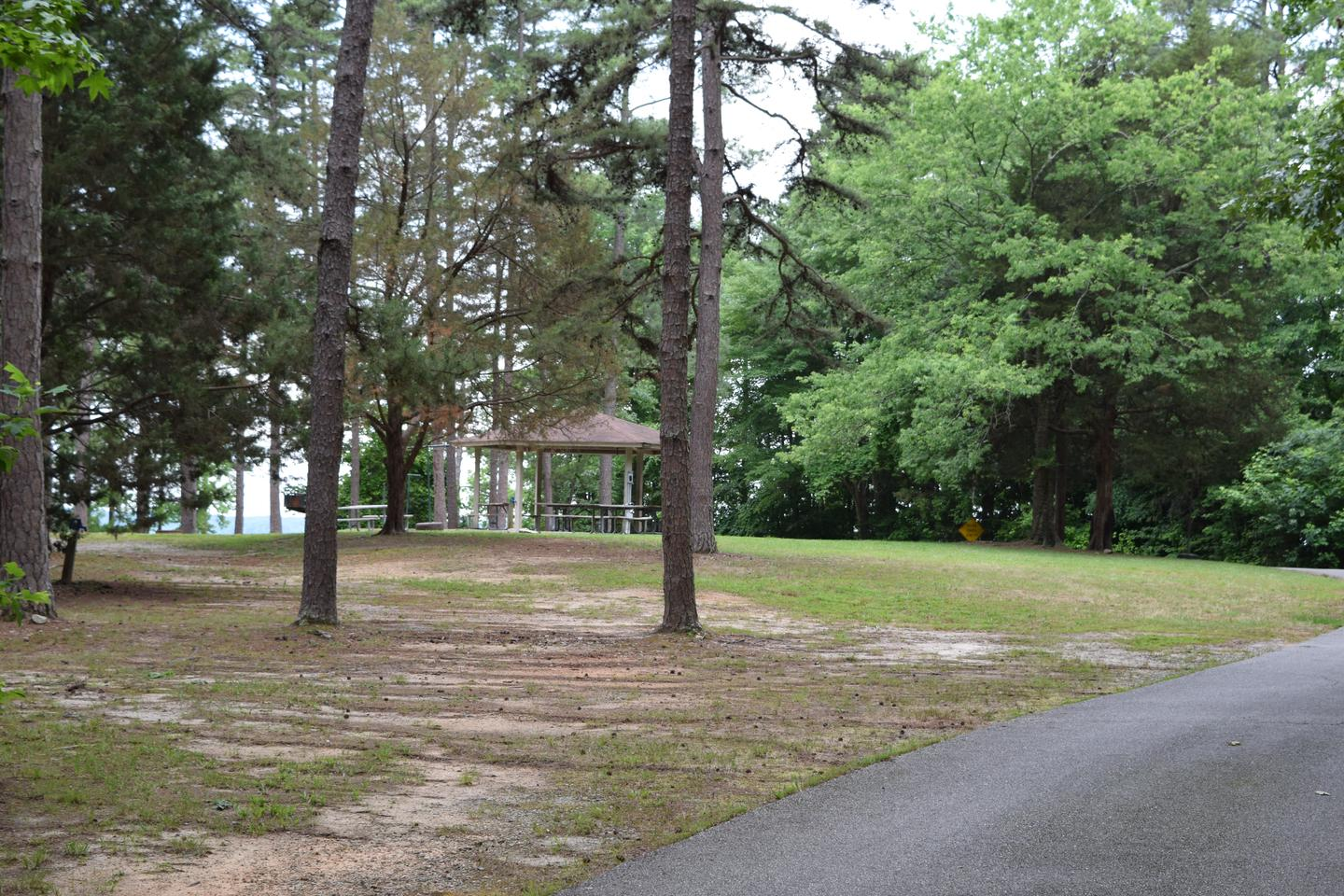 Mays Chapel far away shelterWelcome to Mays Chapel Group Camping Area! This is a picture of the entrance to the group camping area. This has the small shelter in the back ground.