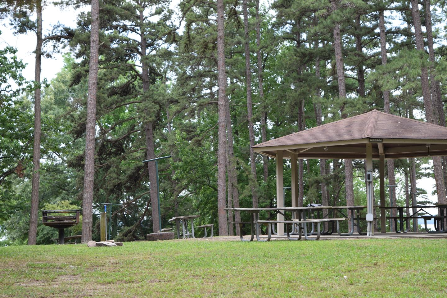 Mays Chapel Group Camping Area Shelter AreaWelcome to Mays Chapel Group Camping Area! This is a picture of the shelter area along with one of the grills located near by. This shelter does have electricity but does not have an electricity hook up for a camper.