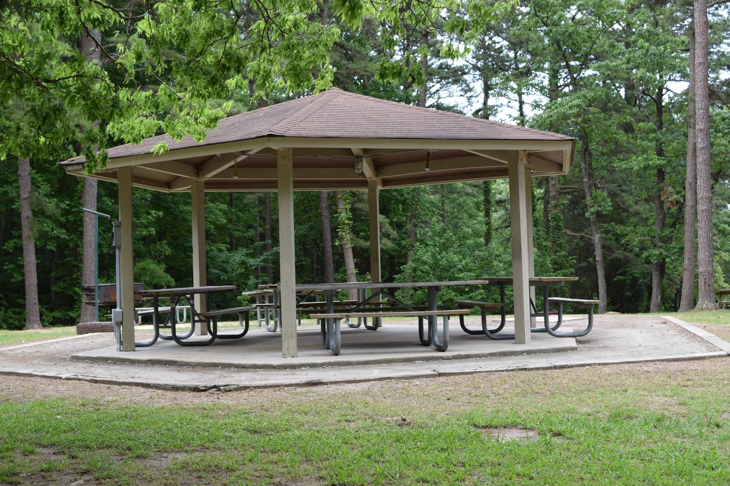 Mays Chapel Group Camping Area ShelterWelcome to Mays Chapel Group Camping Area! This is a picture of the shelter that is located in the area. The shelter does have electricity but does not have an electricity hook up for a camper. There are picnic tables under the shelter. There is also a water spigot near by for your use.