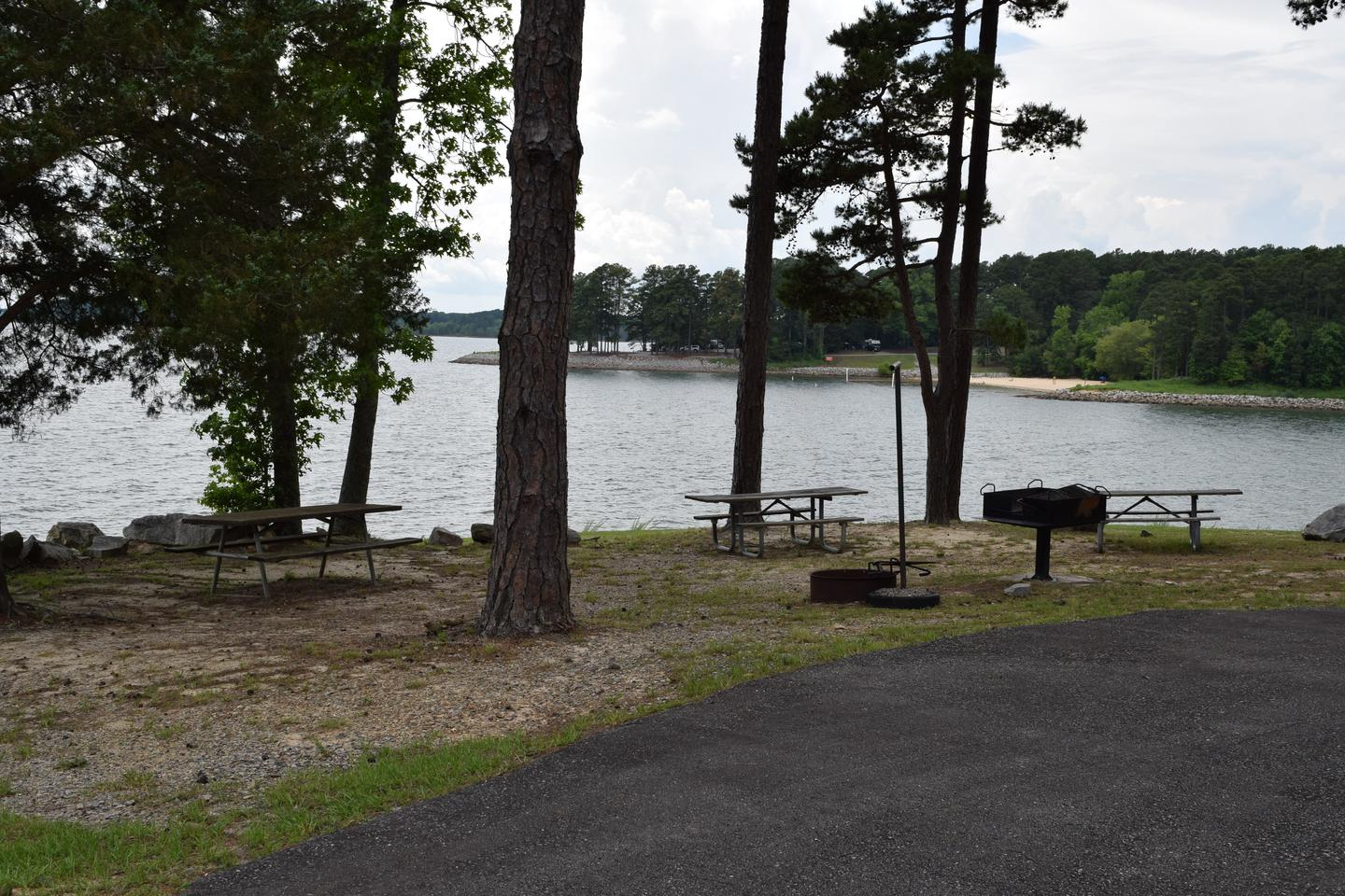Mays Chapel Group Camping Area Turn AroundWelcome to Mays Chapel Group Camping Area! This is a view of the lake from the camping area! This is located near the turn around at the end of the camping area. There are grills and fire rings that you can use.