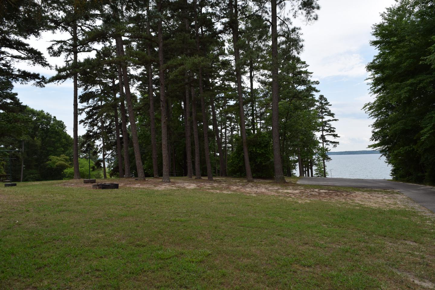 Mays Chapel Group AreaWelcome to Mays Chapel Group Camping Area! This is a picture of the grassy area located behind the shelter. This area has fire rings for you to use as well as lantern holders. There is a small paved parking area within the group camping area.