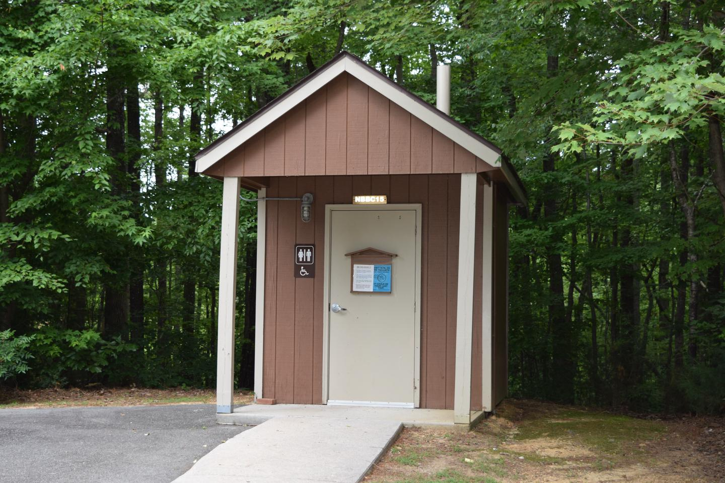 Mays Chapel Group Camping Area Vault ToiletWelcome to Mays Chapel Group Camping Area! This is a picture of the vault toilet located inside the group camping area. This is the only vault toilet in the area. There are other restrooms with flush toilets available around the campground as well as restrooms with showers in them.
